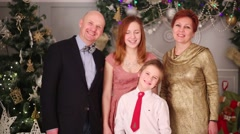 Mother, father and children pose in room with christmas decoration Stock Footage