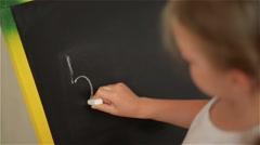 Schoolchild Practicing simple math on chalk board - stock footage