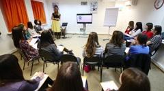 Stylist E.Panyutischeva at Disclosure of feminine style training Stock Footage