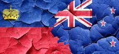 Liechtenstein flag with New Zealand flag on a grunge cracked wal Piirros