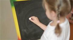 Schoolchild Practicing simple math on chalk board Stock Footage