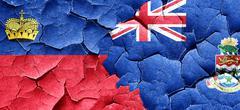 Liechtenstein flag with Cayman islands flag on a grunge cracked Stock Illustration