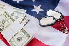 american flag, dollar money and military badges - stock photo