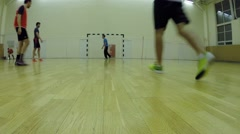 Six people playing indoor mini football in sports hall Stock Footage