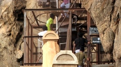 People climb by the stairs to visit Sigiria rock fortress, Sri Lanka. Stock Footage