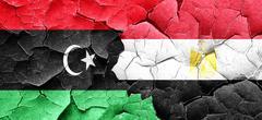 Libya flag with egypt flag on a grunge cracked wall - stock illustration