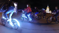 Cyclists ride during First Night Cycling Parade (woman with model release) Stock Footage