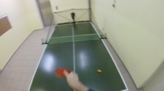 Man plays table tennis with robot, first person view Stock Footage