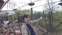 Man makes selfie on ropeway in Rope Park Sky town in VDNKh Stock Footage