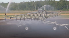 Farmers doing crop irrigation during drought and hot dry weather on farm Stock Footage