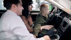 Future driver testing vehicle in dealership. Stock Footage