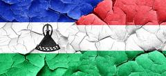 Lesotho flag with Hungary flag on a grunge cracked wall Stock Illustration