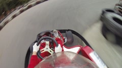 Woman go-cart racing in red car on track at summer, FPV Stock Footage