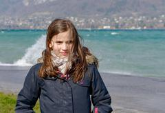 preteen girl with hair in the wind - stock photo