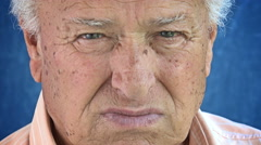 Seniors portrait, contemplative old caucasian man staring at camera Stock Footage