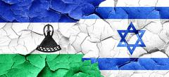 Lesotho flag with Israel flag on a grunge cracked wall - stock illustration