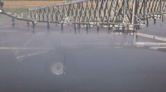 Farmers doing crop irrigation during drought and hot dry weather on farm - stock footage