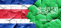 Costa Rica flag with Saudi Arabia flag on a grunge cracked wall Stock Illustration