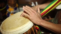 African Percussion - Traditional music. Closeup of man's hands drumming out a - stock footage