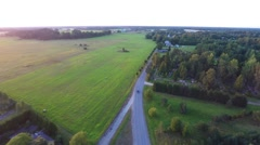 Beautiful summer sunset. Old church. Green fields and forest. Aerial footage. Stock Footage
