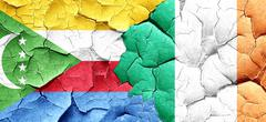 Comoros flag with Ireland flag on a grunge cracked wall - stock illustration