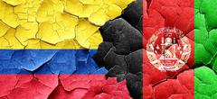 Colombia flag with afghanistan flag on a grunge cracked wall - stock illustration