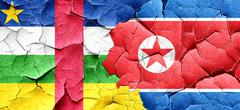Central african republic flag with North Korea flag on a grunge Stock Illustration