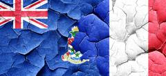 Cayman islands flag with France flag on a grunge cracked wall Stock Illustration