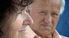 Old married couple portrait: pensive and worried old people, sad elderly people Stock Footage
