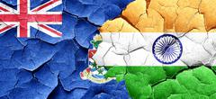 cayman islands flag with India flag on a grunge cracked wall - stock illustration