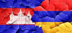 Cambodia flag with Armenia flag on a grunge cracked wall Stock Illustration