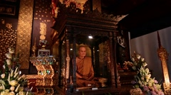 Buddha and monk tribute in Wat Chiang Mai temple. Chiang Mai, Thailand - stock footage