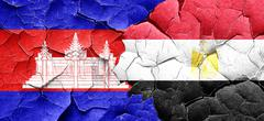 Cambodia flag with egypt flag on a grunge cracked wall Stock Illustration