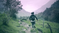 Woman running on cross country trail Stock Footage