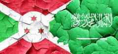 Burundi flag with Saudi Arabia flag on a grunge cracked wall - stock illustration
