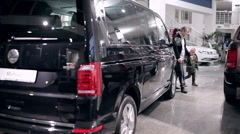 Family is going to buy new minivan - stock footage
