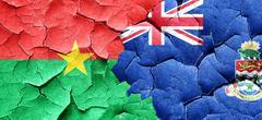 Burkina Faso flag with Cayman islands flag on a grunge cracked w Stock Illustration