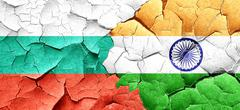 bulgaria flag with India flag on a grunge cracked wall - stock illustration