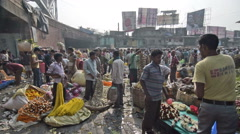 Mallik Ghat flower market in Kolkata, West Bengal, India - stock footage