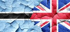 Botswana flag with Great Britain flag on a grunge cracked wall Stock Illustration