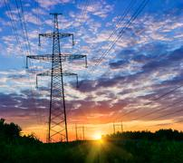 Power lines on a colorful sunrise ,Electric power lines against sky at sunris Stock Photos