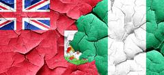 Bermuda flag with Nigeria flag on a grunge cracked wall Piirros