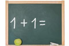 One plus one is written on a blackboard Stock Photos