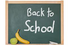 a text for Back to School on a blackboar - stock photo