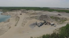 4k aerial view of sand pit and machinery Stock Footage