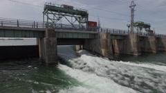 4k aerial water flowing fast under bridge closeup Stock Footage