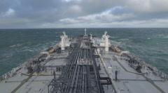 Crude oil tanker is underway in stormy sea. - stock footage