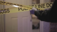 Police Putting Up Caution Tape - stock footage