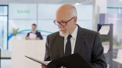 4K Portrait of friendly smiling financial advisor in the bank Stock Footage