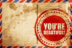 you're beautiful!, red grunge stamp on an airmail background - stock illustration
